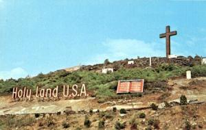 A 1960s postcard image of Holy Land USA's hillside sign (image courtesy wikimedia commons).